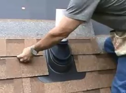 Loudoun county roofer repairing a leaky roof vent pipe